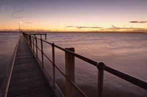 Landscape image at twilight of St Kilda pier, Melbourne, Australia.
