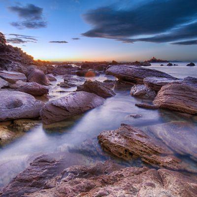 Rocks under Mount Maunganui, New Zealand at twilight