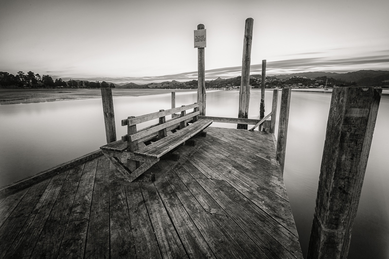Long exposure landscape photo wharf Tairua Harbour Pauanui Coromandel Peninsula New Zealand