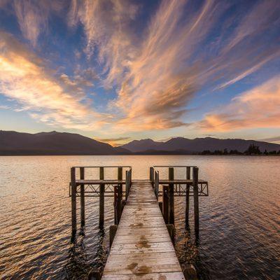 Landscape photo sunset jetty Lake Te Anau Fiordland New Zealand