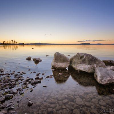 Landscape photo of sunset over Lake Taupo, New Zealand