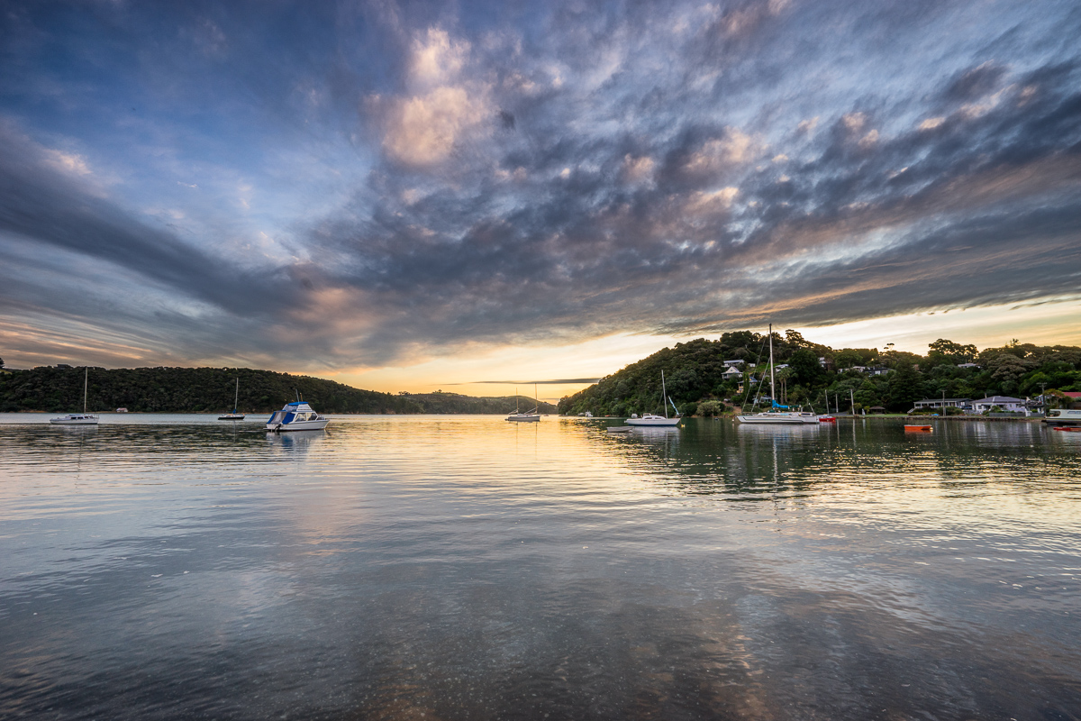 Landscape photo of sunset over boats on Waiheke Island, New Zealand