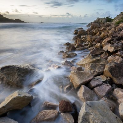 Long exposure landscape of waves on rocks of Moturiki Island, Mt Maunganui, New Zealand