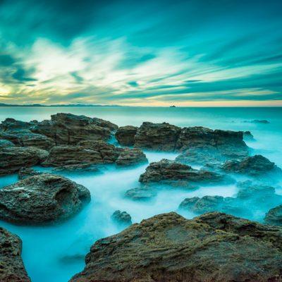 Long exposure landscape photo of rocks at sunset, Mt Maunganui, New Zealand