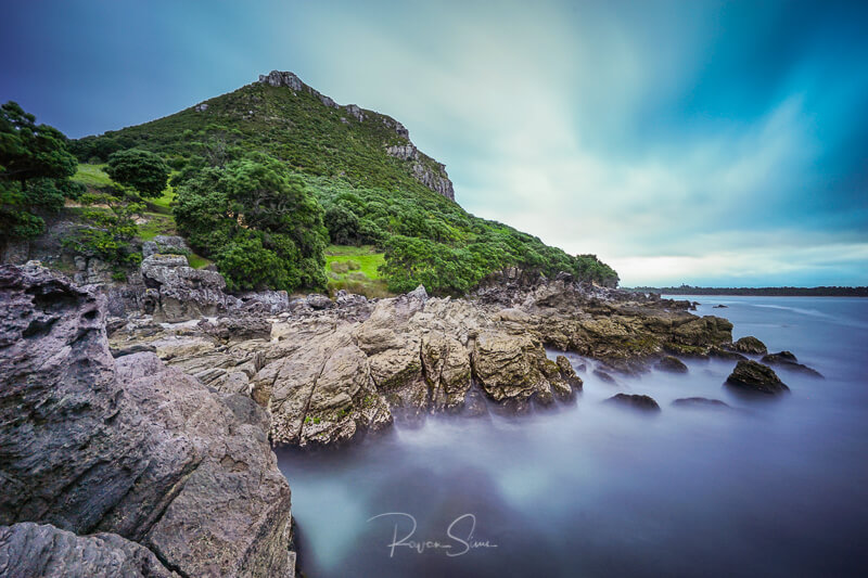 Canvas print of rocks under Mount Maunganui New Zealand