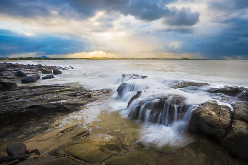 waves crashing over rocks in Noosa National Park, Noosa Heads, Sunshine Coast, Queensland, Australia