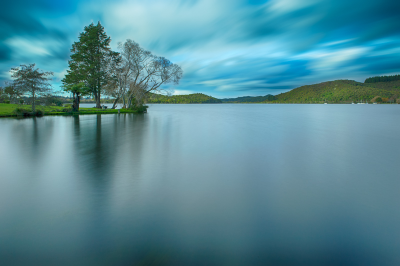 Long exposure of Lake Rotoiti, Rotorua, New Zealand from Amora Lake Resort. Long exposure lake photography