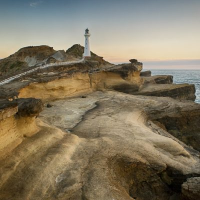 Landscape photo of the light house at Castlepoint, Wairarapa, New Zealand.