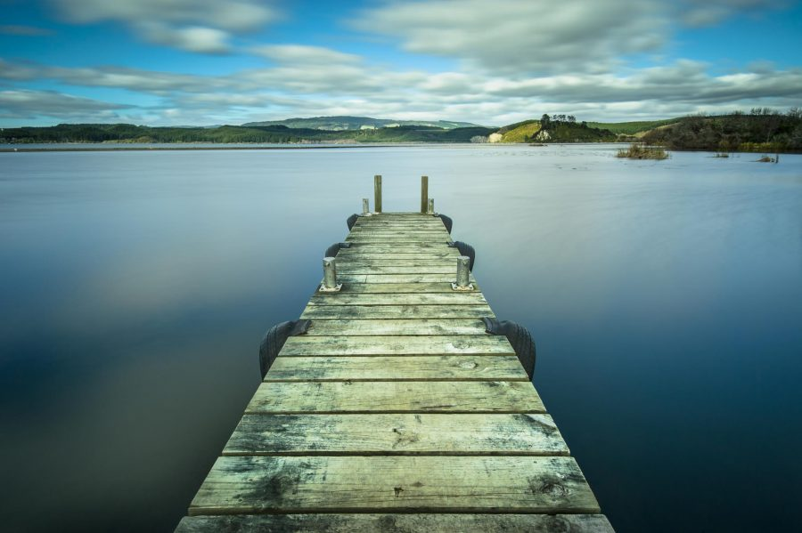 Long exposure landscape photo of a jetty in Waipuna Bay, Lake Rotoiti, Rotorua, NZ