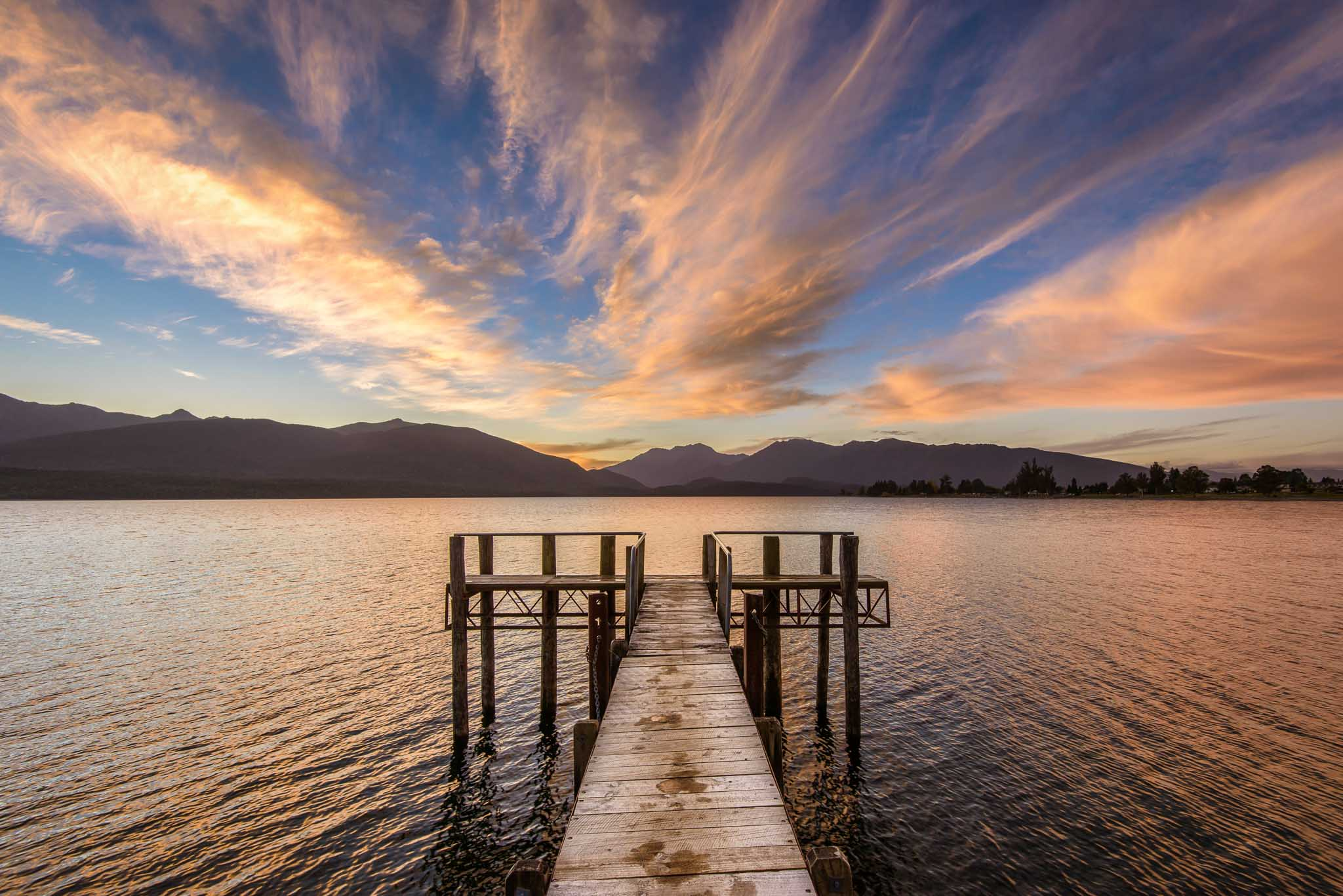 Landscape photo sunset jetty Lake Te Anau Fiordland New Zealand