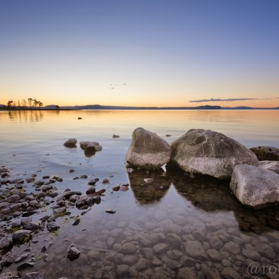 Landscape photo of sunset over Lake Taupo, New Zealand