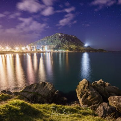 Mount Maunganui at night from Leisure Island with stars overhead