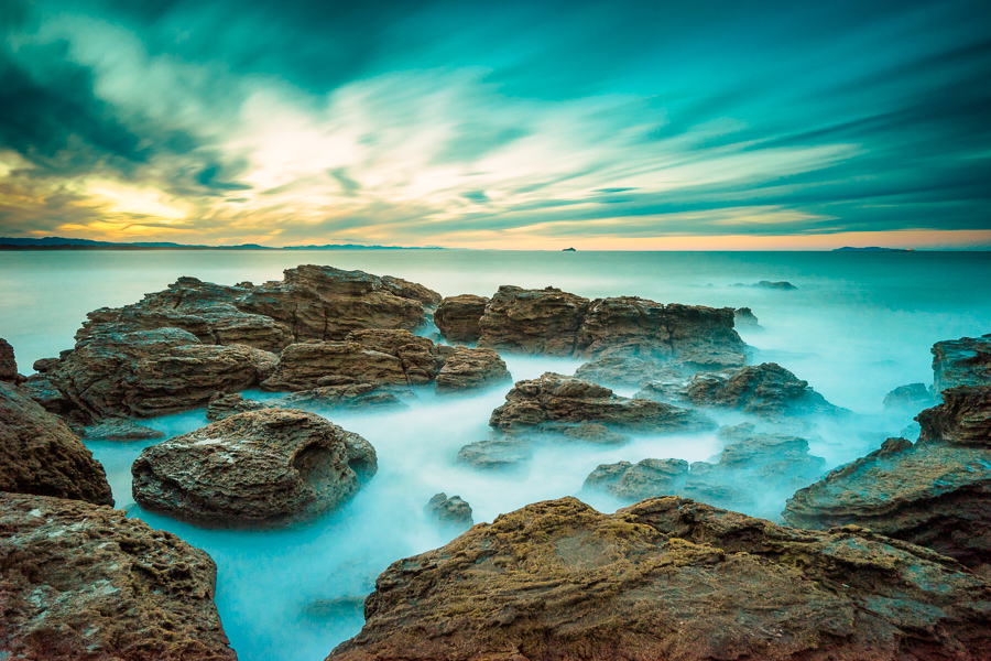 Long exposure landscape photo of rocks at sunset, Mt Maunganui, New Zealand