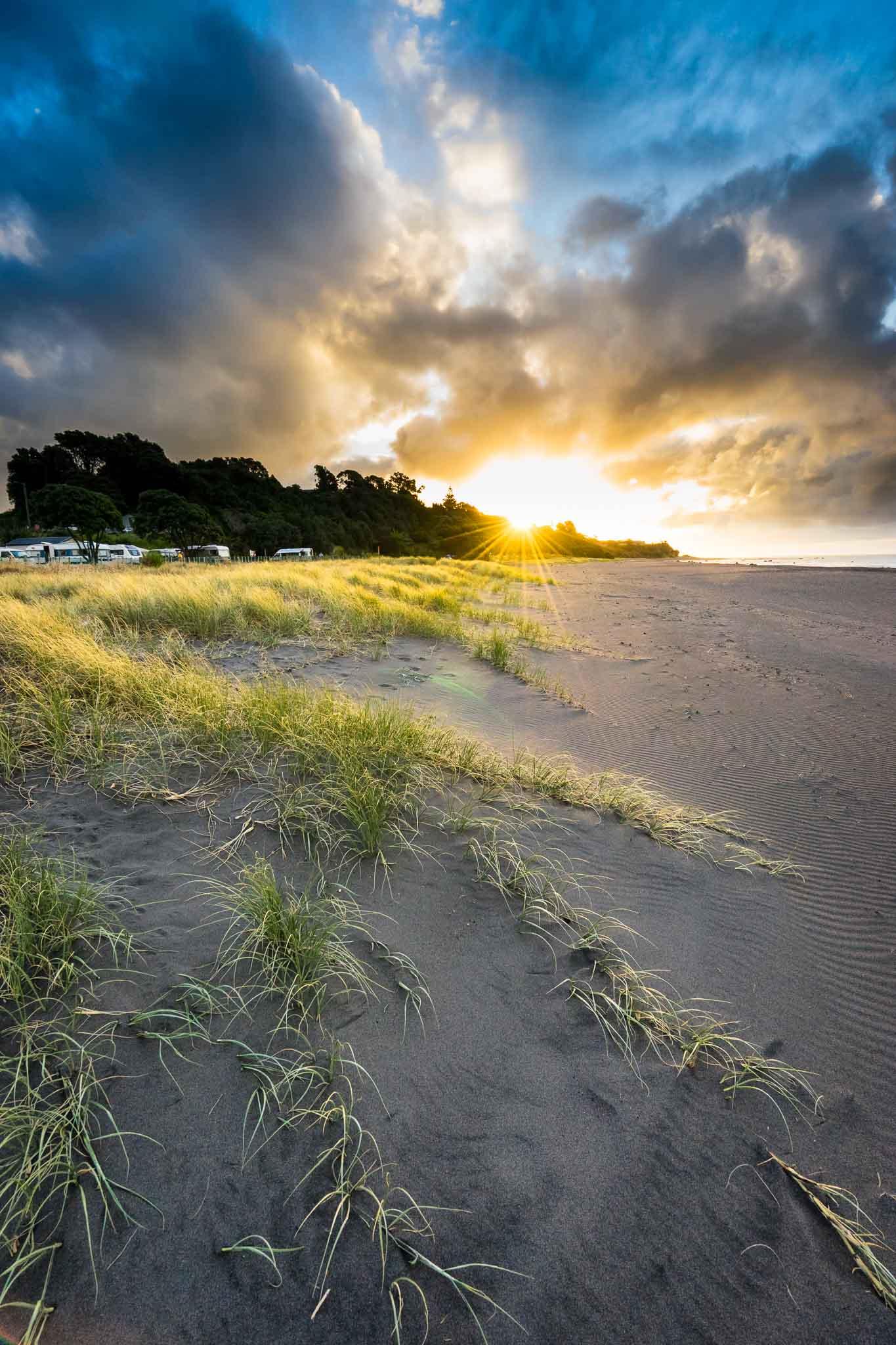 Sunset over Oakura Beach Holiday Park, Taranaki, New Zealand