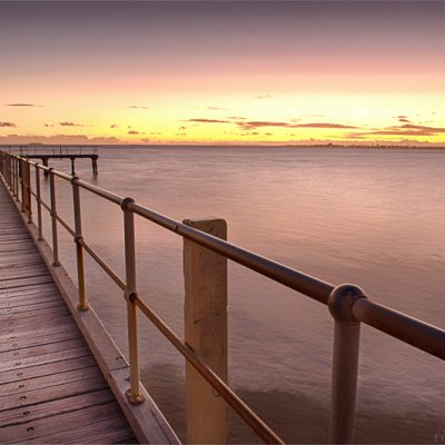 Landscape photo of Brooks Jetty, St Kilda Beach at twilight in Melbourne, Australia.