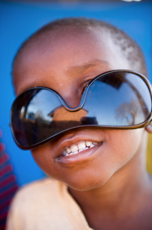 african-boy-sunglasses-mozambique-child-photography-tips