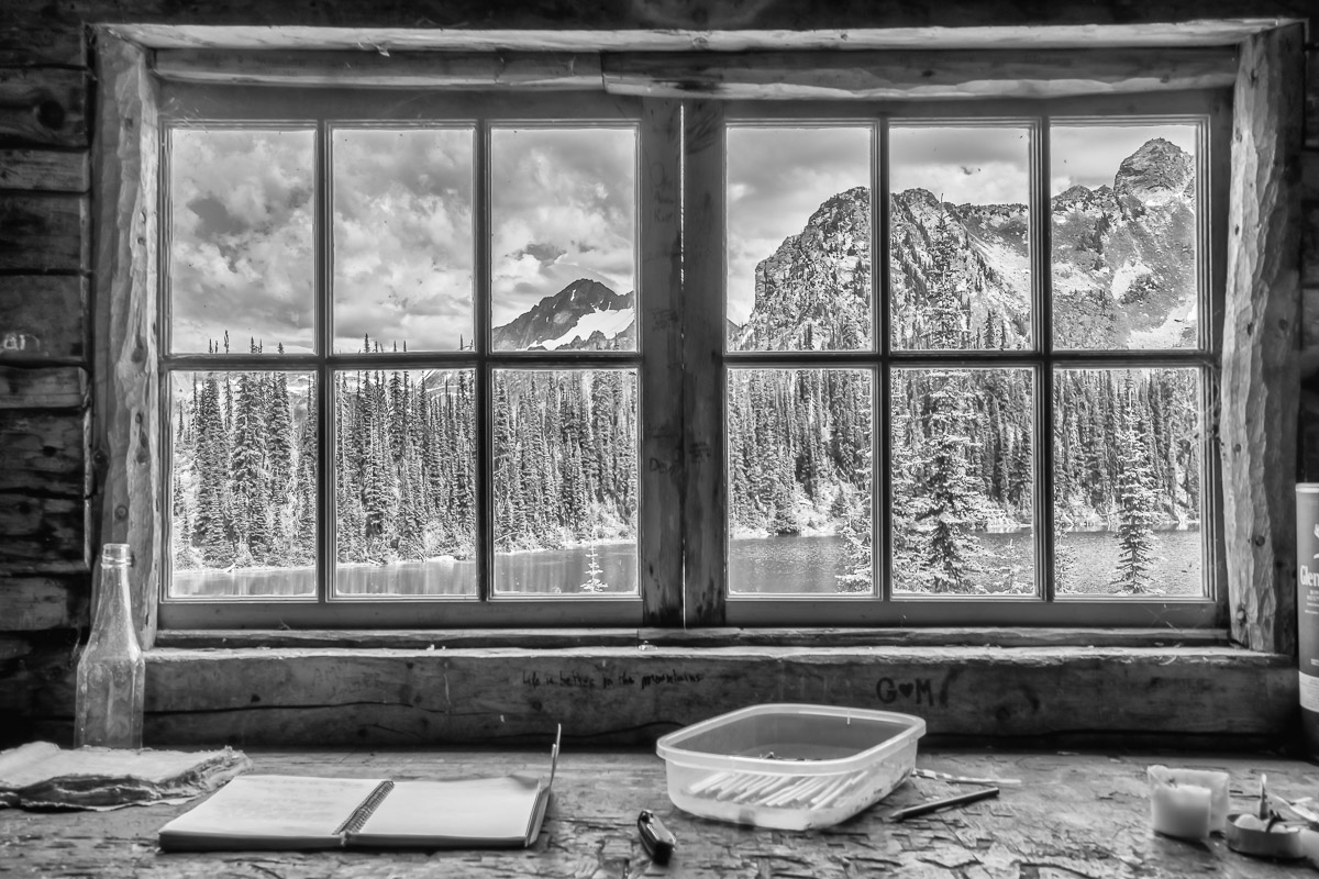 View of Eva Lake through a cabin window in Mount Revelstoke National Park, British Columbia, Canada