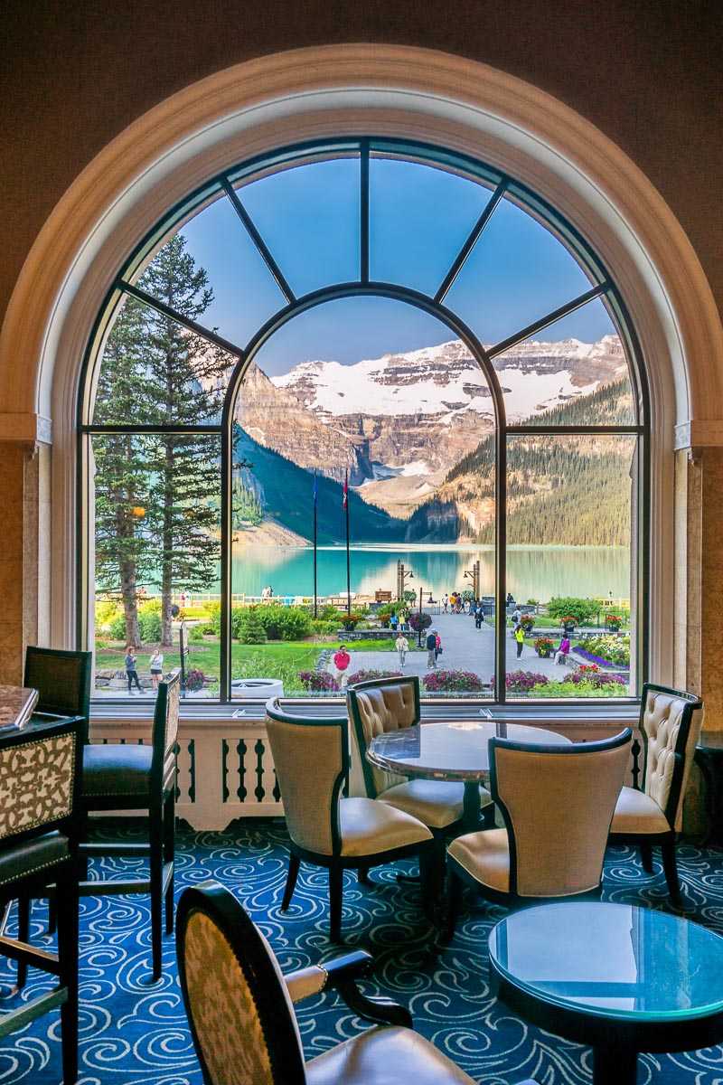 View of Lake Louise through a window Fairmont Chateau Lake Louise Banff National Park Alberta Canada