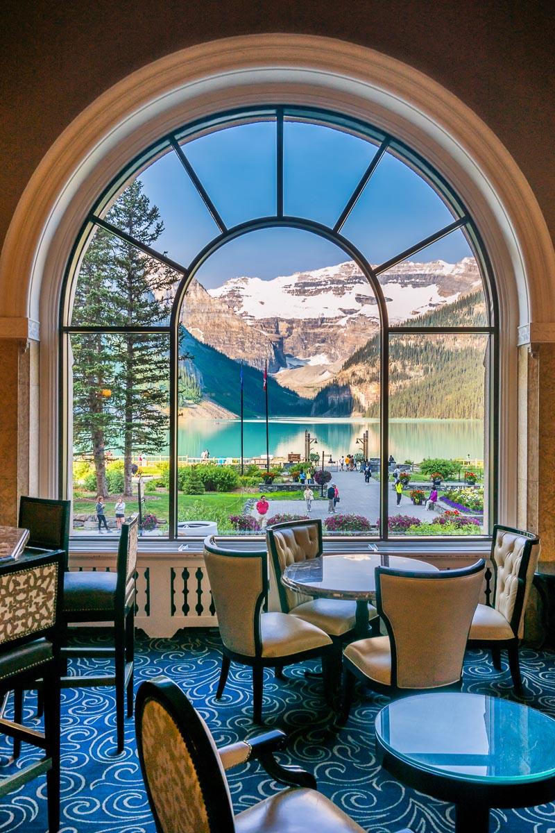 View of Lake Louise through a window Fairmont Chateau Lake Louise Banff National Park Alberta Canada