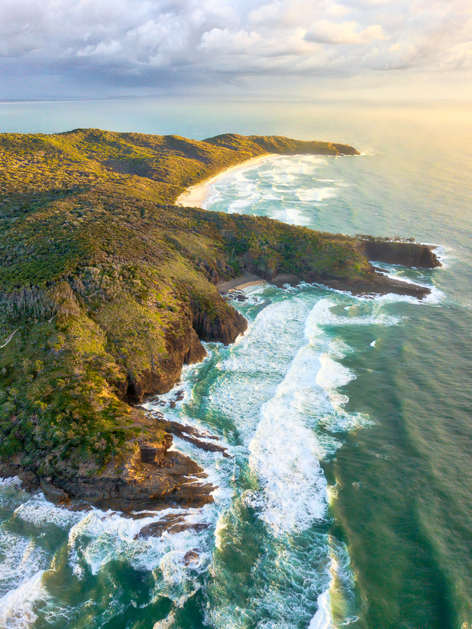 Aerial photo of sunrise over Noosa National Park, Noosa Heads, Sunshine Coast, Queensland, Australia