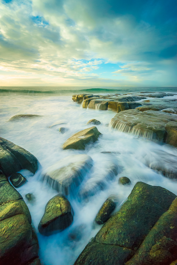 how to take sharper photos waves crashing over rocks at sunrise at Point Cartwright Beach, Sunshine Coast, Queensland, Australia