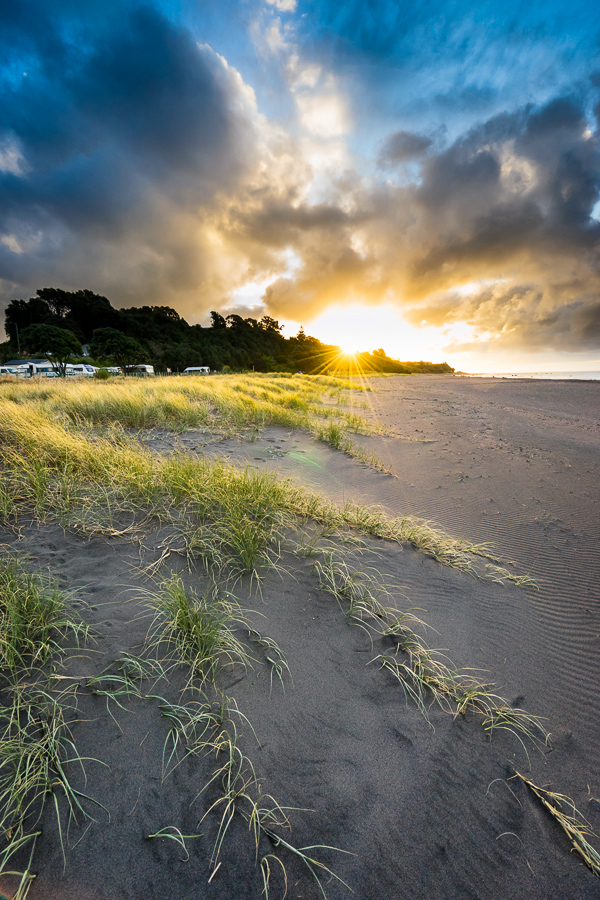 Sunset over Oakura Beach Holiday Park, Taranaki, New Zealand