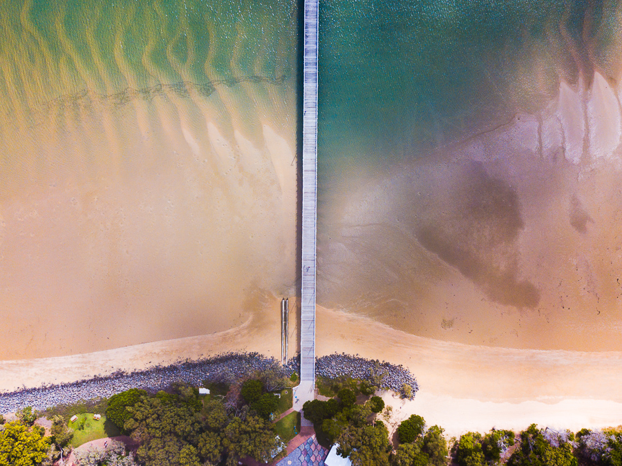 Aerial photo of sunrise over Urangan Pier, Hervey Bay, Fraser Coast, Queensland, Australia