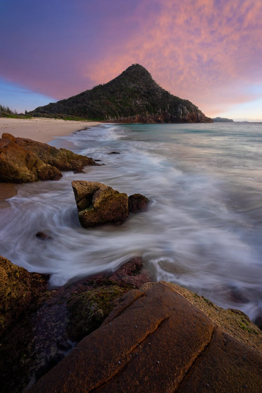 View of Tomaree Mountain from Zenith Beach at sunrise, Port Stephens, NSW, Australia.
