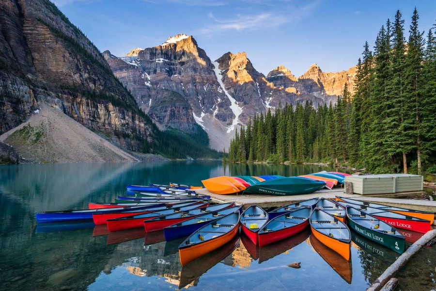 Canoes on Moraine Lake at sunrise, Banff National Park, AB, Canada