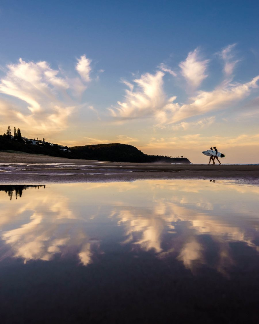 Surfers on Sunshine Beach at sunset, Noosa Heads, Sunshine Coast, QLD, Australia.